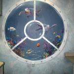 large porthole behind reception desk